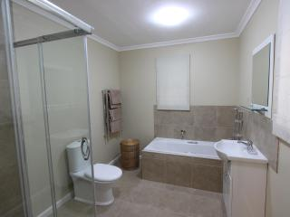 Bathroom with separate bath tub and shower