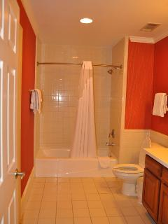 Full bath with shower tub and plenty of towels.
