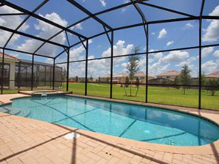 Private south facing pool deck with hot spa