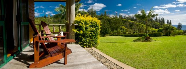 Kushu Cottage - Verandah set among lush sub-tropical gardens with sweeping ocean views. Weber BBQ.