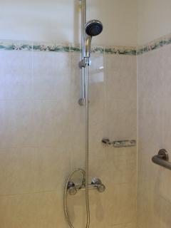 Hand held shower in both shower rooms