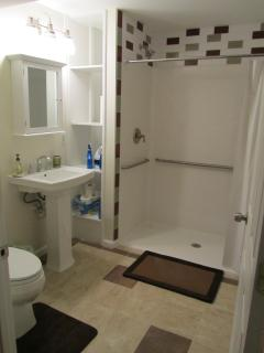 Ground level wheelchair accessible shower