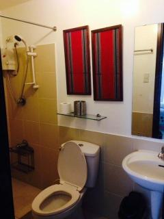Toilet & Bath with Bidet and Hot shower and ample room for toiletries