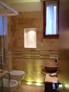 The luxury private bathroom in precious Italian travertine marble
