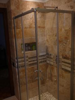 The luxury private bathroom in precious Italian travertine marble - The shower
