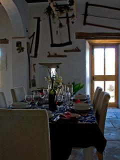 dining area with a collection of antique tools from the area