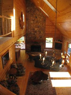 view from stairs to fireplace