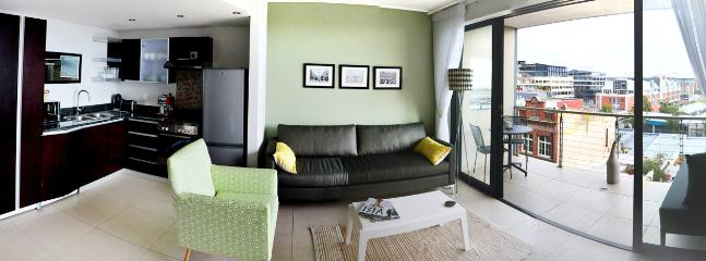 Living area, kitchen and balcony