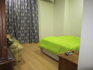 Queen size complete room with air con, fan, sofa, 2 side tables & cupboard