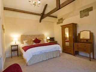 Sheep Pen Cottage master bedroom enjoys a bathroom ensuite with separate shower