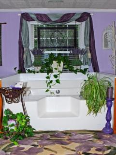 Mystic Suite Bathroom features a Large Garden Tub, a Corner Shower and a Two Sink Cabinet