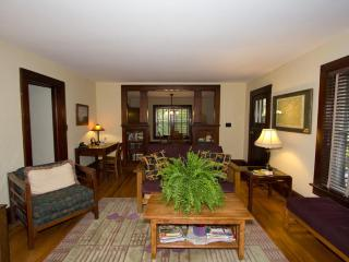 open living room/dining room. Original hardwood floors throughout, beautiful detailed woodwork