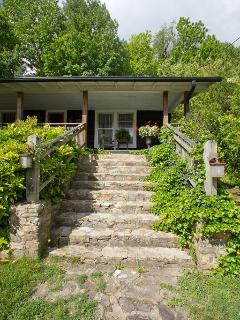 Ivy draped stone front steps. Enter back door for ground level entrance.
