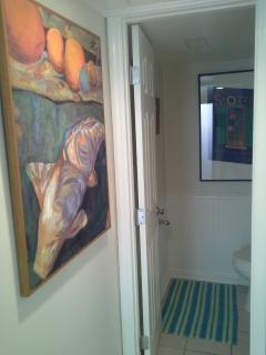 View from downstairs hallway into powder room