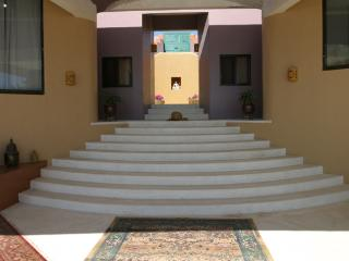 Steps up to the courtyard from the living area