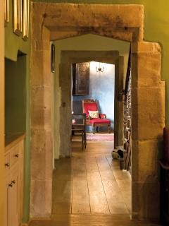 Blencowe Hall has solid oak floors throughout.  This view is from the Snug to the Billiards Room