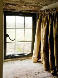 The window in the South Tower Master Bedroom dressing room overlooking the orchard field