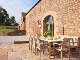 Glassonby Old Hall's sandstone terrace - a great place to relax after exploring in the Lake District