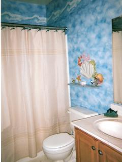 Bathroom with full bath tub and shower.  Also has a Hot/Cold outside shower and dressing room