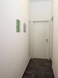 Hall to the bedroom (bathroom on the right)