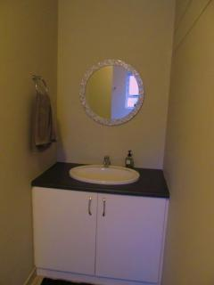 Bathroom with basin and mirror