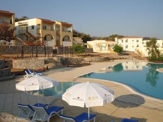 Pool area with umbrellas and sun loungers free for all guests to use during their stay