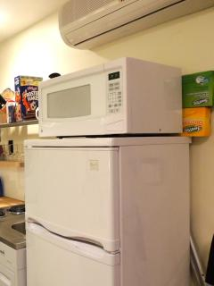 Lots of room for your fresh and frozen goodies and a new microwave to heat them!