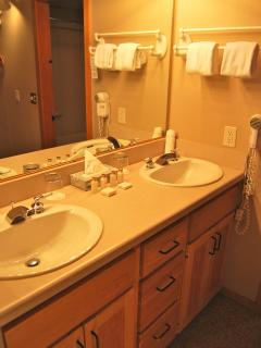Double sinks, spa toiletries, plenty of cabinet and drawer space