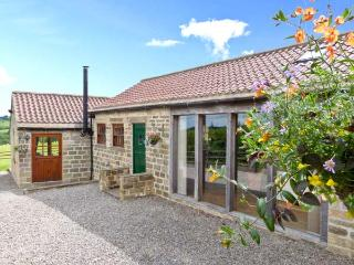 SALLY'S BARN, detached, all ground floor, woodburner, parking, garden, in Grantley, Ref 5922