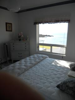 Master bedroom with new bed - gorgeous ocean view