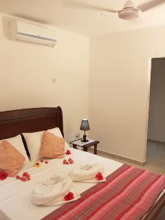 Garden View Villa - queen size bed in new villa at Coco Blanche