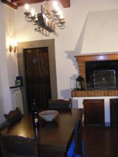 The open fireplace in the cosy kitchen - First Floor