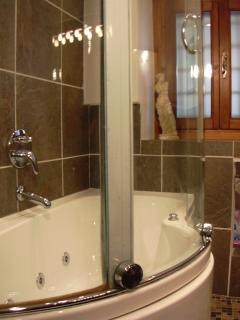 The bathroom with Jacuzzi bath tub - Ground Floor Apartment