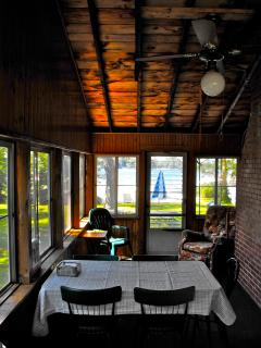 Dine, relax & even sleep on screened porch overlooking lake