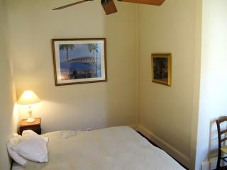 Bedroom with either large bed or two twin beds.