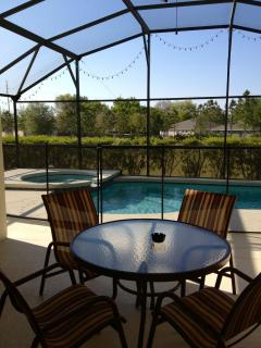 Private relaxing pool dining area, facing on to water retention pond