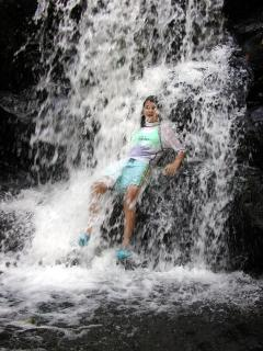 A refresing 'shower' at one of the many nearby waterfall