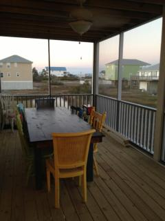 Screened Back Porch with views of the Bay and Gulf Seats 8