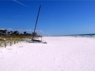 On the Beach. View of the High-rises of the Panama City Beach on the horizon