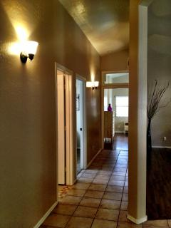 Hallway leading to bedrooms and guest full bathroom.