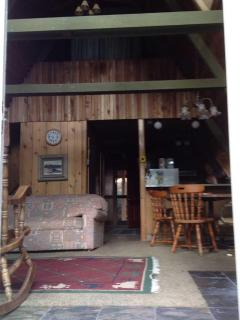 Lofted 'great room' with wood stove and table.