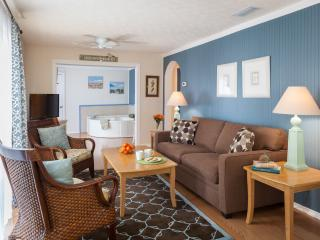 Living Room with queen sofa bed/wood flooring