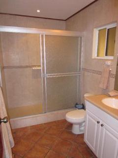 This is the smaller bathroom that connects directly to the 2nd bedroom and the hallway.
