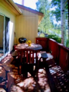 Deck in summer with dining and bar-b-q