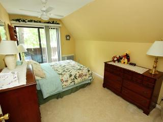 Bedroom with a queen size bed and walkout balcony