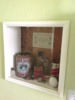 'Truth Window' showing the adobe brick structure & vintage artifacts found during the renovation.