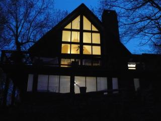 A view from the lakeside of the house at dusk