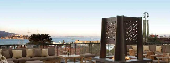 The beautiful Mustard Terrace with outdoor fire pit, overlooking the bay and Alcatraz.