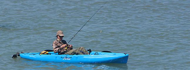 Kayak fisherman near our dock