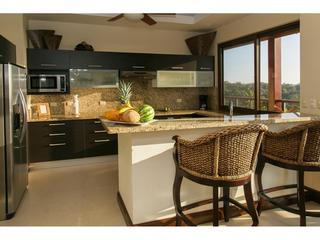 Kitchen with granite countertops, Italian cabinetry, and stainless steel appliances.